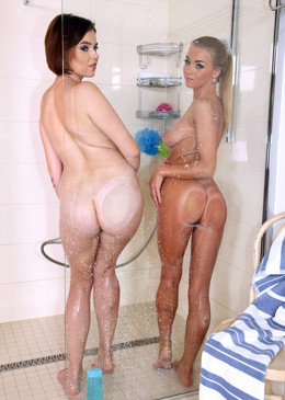 Two sexy babes posing during washing..
